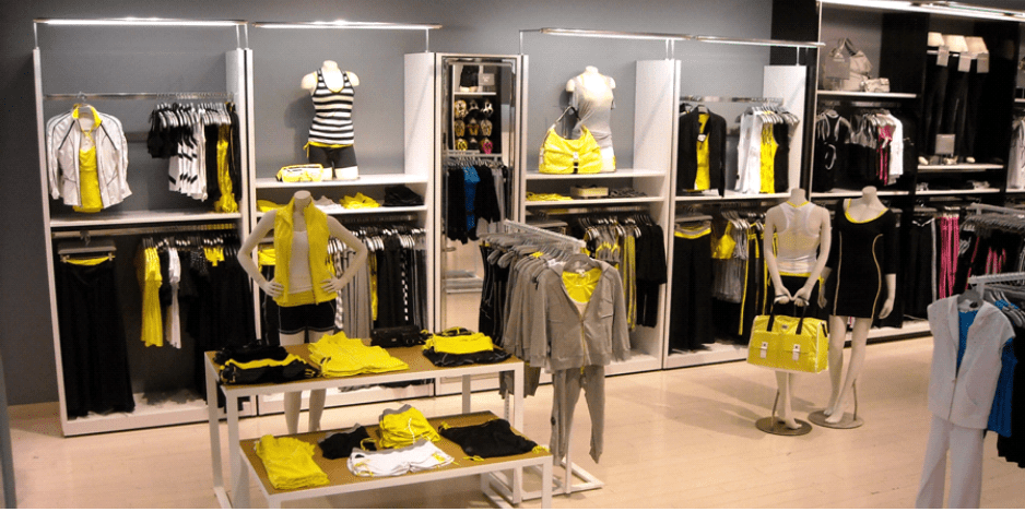 Photograph of clothing for sale in an in-store retail display, from Double Impact Displays.